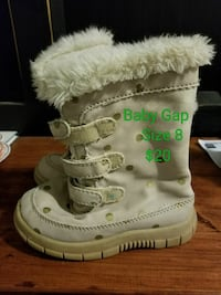 toddler's pair of white Gap boots 625 km