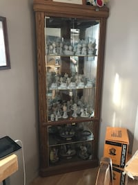 Corner curio cabinet with 3 glass selves. and 2 lights