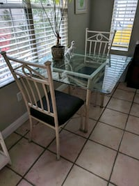 Glass dining room table and chair set Costa Mesa, 92627