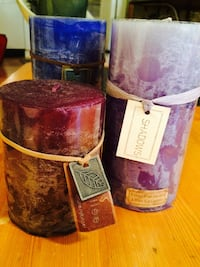 Three assorted color pillar candles