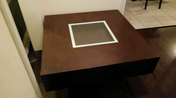 Hardwood coffee table with glass center