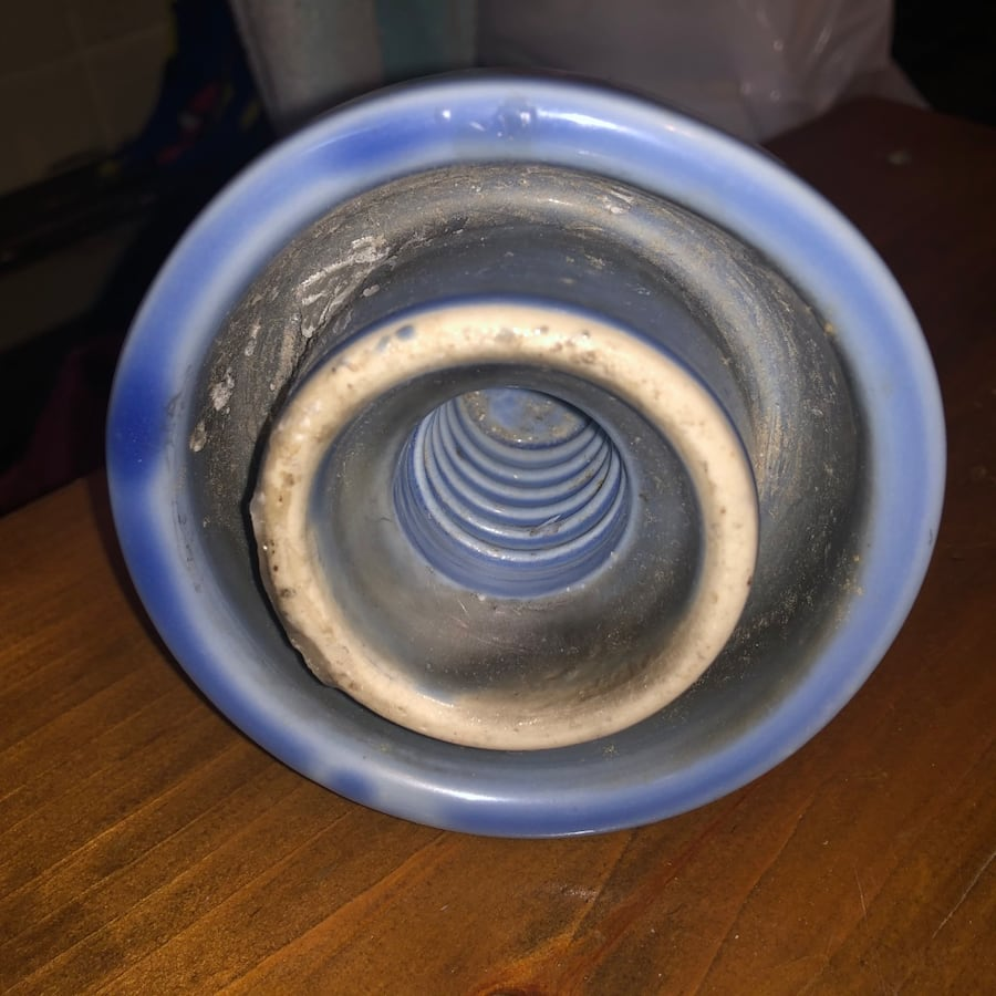 Antique blue ceramic insulator