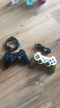 Two black and one white sony ps3 controllers Surrey, V3W 0E7