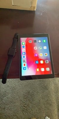 Apple iPad 5th generation with cellular and series 3 Apple Watch 42mm