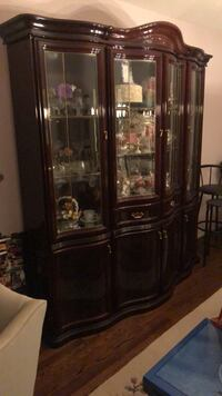 brown wooden framed glass display cabinet 553 km