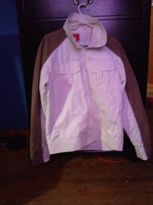 White and brown zip-up jacket
