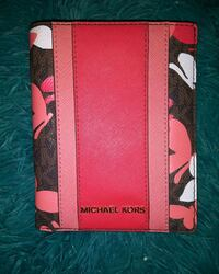 Michael Kors passport wallet. Brand new