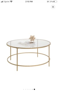 Gold glass top coffee table.