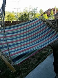 brown, red, blue, and green striped hammock