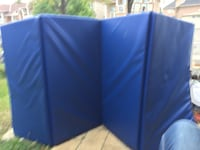 Blue and white plastic gymnastic mat