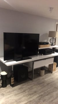 Flat screen tv and white wooden tv stand 793 km