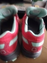 Running and walkpair of red-andgreen Salomon shoes Kelowna, V1X 7Z6