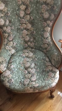 gray and white floral fabric sofa chair