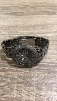Round black chronograph watch with silver link bracelet Manchester, 03103