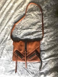 brown and black leather crossbody bag 774 km