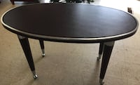 Oval shaped table with casters $50