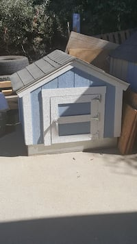 grey and blue wooden pet house