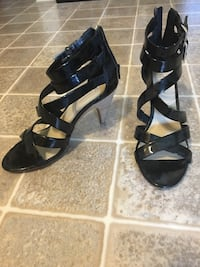 Pair of black leather open-toe ankle strap heels Seattle, 98103