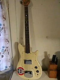 brown and white electric guitar Baltimore, 21205