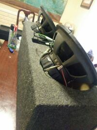 Its a Kicker brand Subwoofer box with port for amp