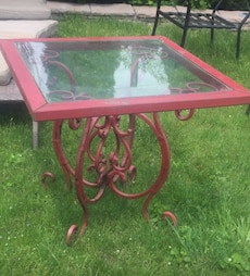 red metal base and glass top table