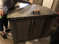 24sqin diameter island (1 year old) blister on cabinet (cosmetic-easily repairable) easy install kitchen island with counter bar included.  null
