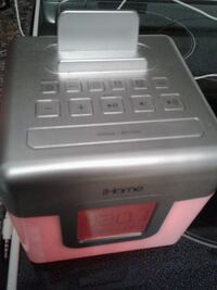 gray and pink iHome dock speaker with digital cloc