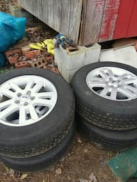 silver Ford 5-spoke vehicle wheel and tire set Knoxville, 37918