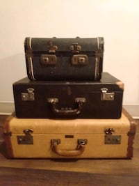 Vintage suitcases, phone and trunk.
