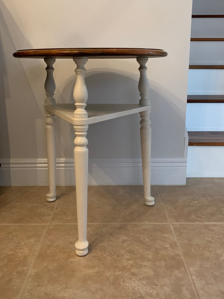 Photo Vintage 3 legged occasional/side table with shelf. Refinished.