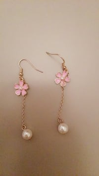 pair of white pearl drop gold-colored drop chain hook earrings