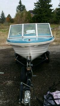14 foot boat, motor and trailor. 50 hp Johnson.