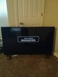 black flat screen TV with remote Spartanburg, 29306