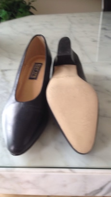 Pair of black leather shoes. Size 8 . Never been worn .