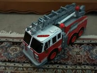 children's red, white, gray and black plastic firetruck toy