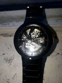round black chronograph watch with black link bracelet Vancouver, V5L 1H3