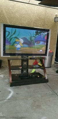 Sony TV 55 inches with black stand include  2274 mi
