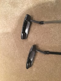 two black golf putters Whitby, L1P 1N5