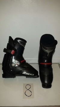 pair of black Norcica boots with box