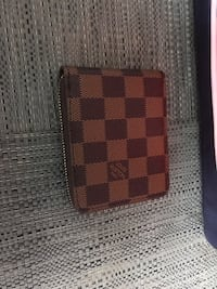 brown and black Louis Vuitton leather wallet 785 km