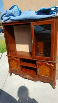 brown wooden TV hutch with flat screen television Pomona, 91766