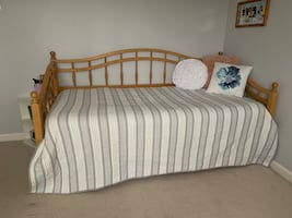 Wood twin trundle bed with bottom frame.