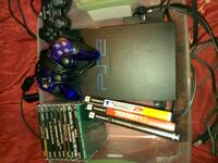 PS2 with games and controllers 2401 mi