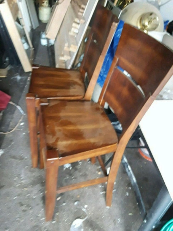 Two brown wooden chair