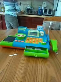 blue, green, and white plastic cash register toy