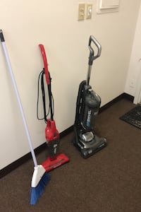 2 vaccums and a broom