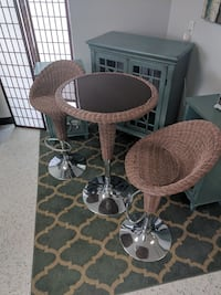 round brown wicker table with two chairs Houston, 77041
