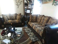 brown and black floral fabric sofa set
