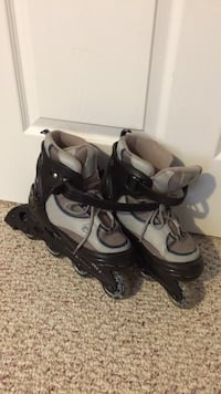 Pair of gray and black inline skates Halifax, B4E 3L4
