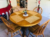 round brown wooden table with four chairs dining set Washington, 20024